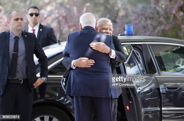 Israeli President Reuven Rivlin and Indian Prime Minister Narendra Modi embrace during a welcome ceremony at the president's official residence in...