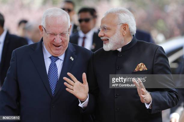 Israeli President Reuven Rivlin chats with Indian Prime Minister Narendra Modi during a welcome ceremony at the president's official residence in...