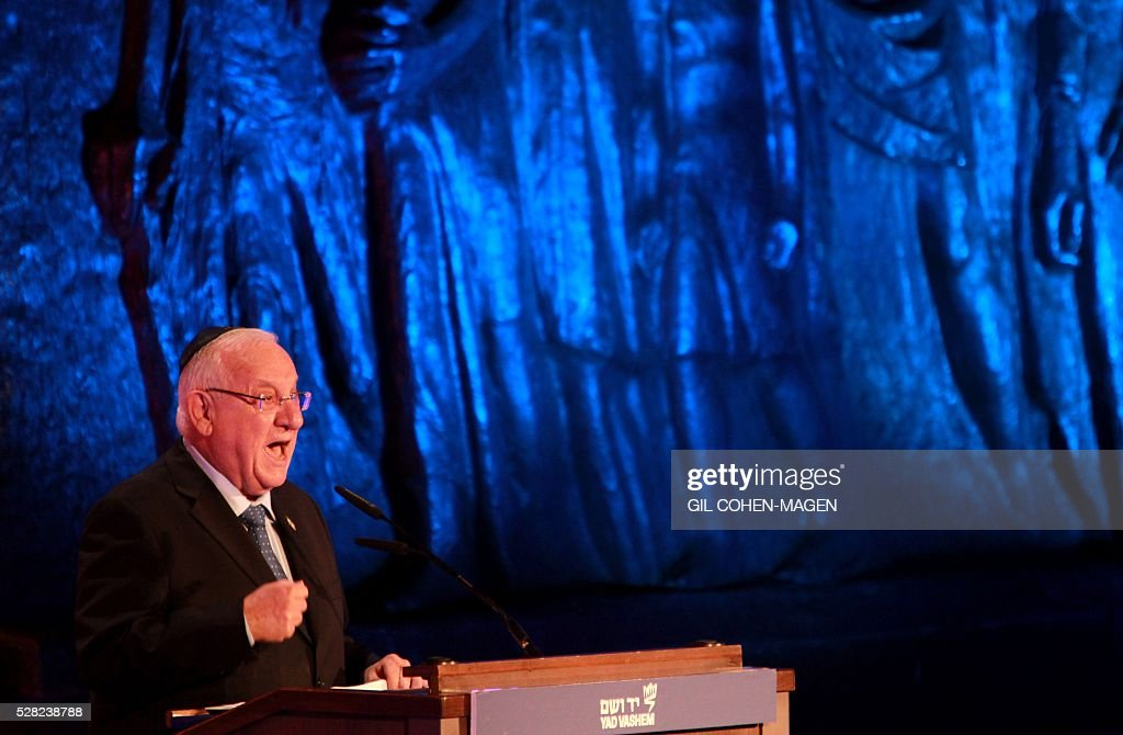Israeli President Reuven Rivlin delivers a speech during a ceremony marking the Holocaust Remembrance Day on May 4, 2016 at the Yad Vashem Holocaust memorial in Jerusalem. Holocaust Remembrance Day, commemorating the six million Jews killed by the Nazis during World War II, is an internationally recognized date corresponding to the 27th day of Nisan on the Hebrew calendar and begins this year in the evening of May 4 and ends in the evening of May 5. / AFP / Gil Cohen-Magen