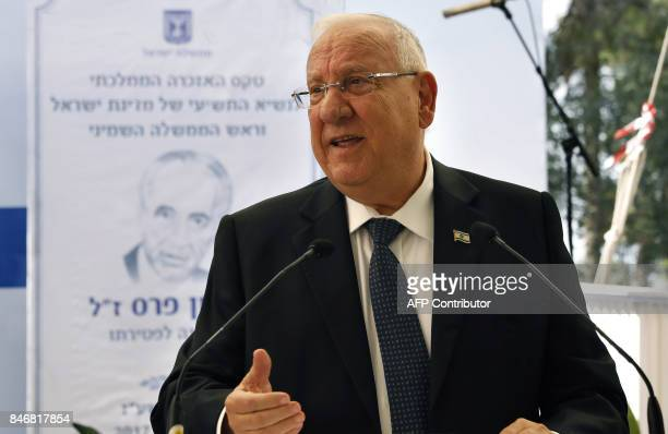 Israeli President Reuven Rivlin delivers a speech during a ceremony marking one year since the death of the late Israeli President Shimon Peres on...