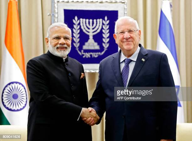 Israeli President Reuven Rivlin shakes hand with Indian Prime Minister Narendra Modi at the president's official residence in Jerusalem on July 5...