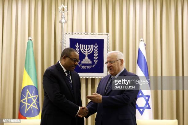 Israeli President Reuven Rivlin shakes hand with Prime Minister of Ethiopia Hailemariam Desalegn at the beginning of their meeting at the...