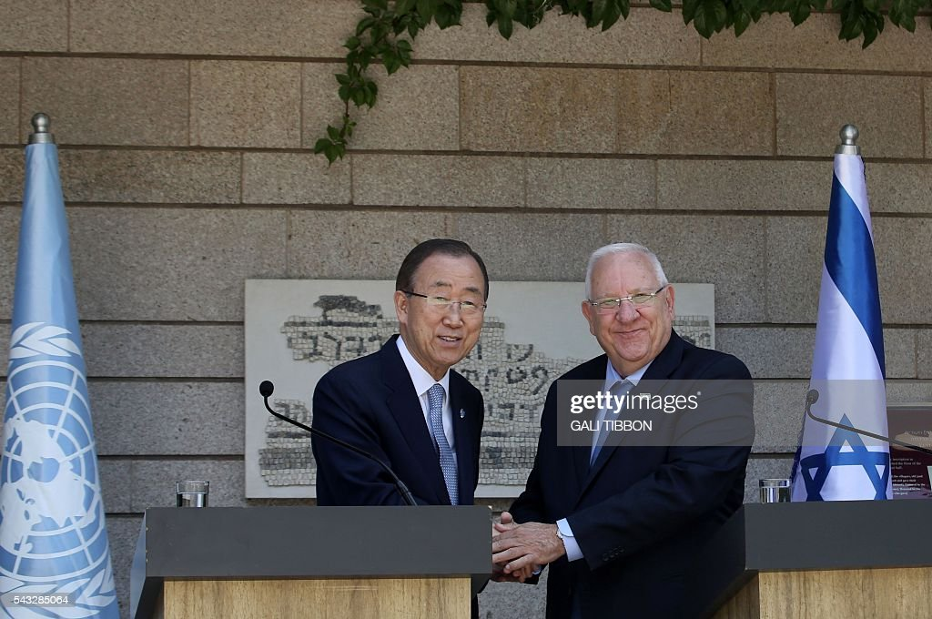 Israeli President Reuven Rivlin (R) shakes hands with UN Secretary General Ban Ki-moon before a meeting at the presidential compound on June 27, 2016 in Jerusalem. UN chief Ban Ki-moon on Monday urged Israelis and Palestinians not to allow extremists on either side to fan violence, as he arrived as part of a Middle East tour. TIBBON