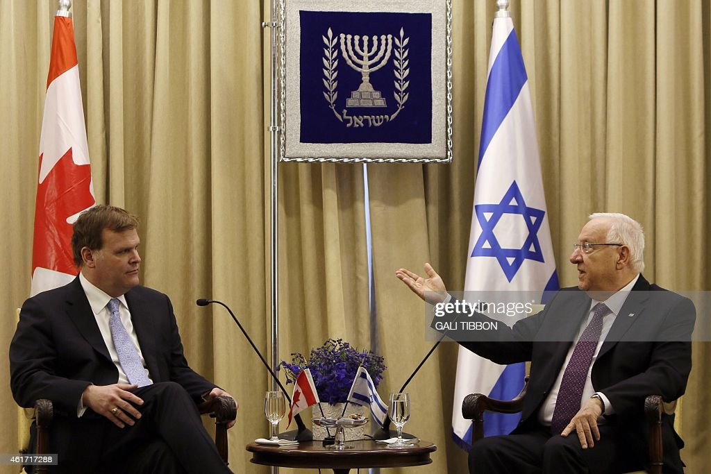 Israeli President <a gi-track='captionPersonalityLinkClicked' href=/galleries/search?phrase=Reuven+Rivlin&family=editorial&specificpeople=716592 ng-click='$event.stopPropagation()'>Reuven Rivlin</a> (R) talks with Canada's Foreign Minister <a gi-track='captionPersonalityLinkClicked' href=/galleries/search?phrase=John+Baird+-+Canadian+Politician&family=editorial&specificpeople=10720753 ng-click='$event.stopPropagation()'>John Baird</a> (L) during their meeting at the presidential compound in Jerusalem on January 18, 2015. AFP PHOTO/GALI TIBBON