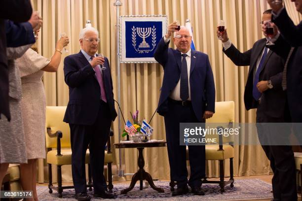 Israeli President Reuven Rivlin toasts with new US ambassador to Israel David Friedman during a credentials presentation ceremony on May 16 in...