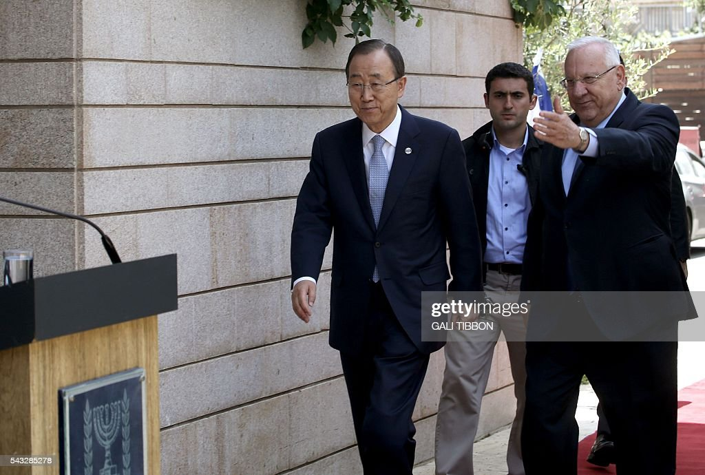 Israeli President Reuven Rivlin (R) welcomes UN Secretary General Ban Ki-moon upon his arrival at the presidential compound for a meeting on June 27, 2016 in Jerusalem. UN chief Ban Ki-moon on Monday urged Israelis and Palestinians not to allow extremists on either side to fan violence, as he arrived as part of a Middle East tour. TIBBON