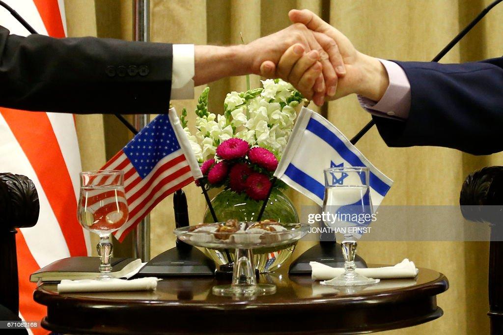 Israeli President Reuven Rivlin (R) welcomes US Defence Secretary James Mattis (L) in Jerusalem on April 21, 2017. /
