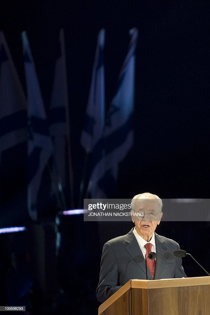 Israeli President Shimon Peres addresses a ceremony honoring World War II veterans and marking the 65th anniversary of the Allied victory over Nazi Germany at the Armored Corps Memorial and Museum at Latrun Junction near Jerusalem on May 25, 2010.