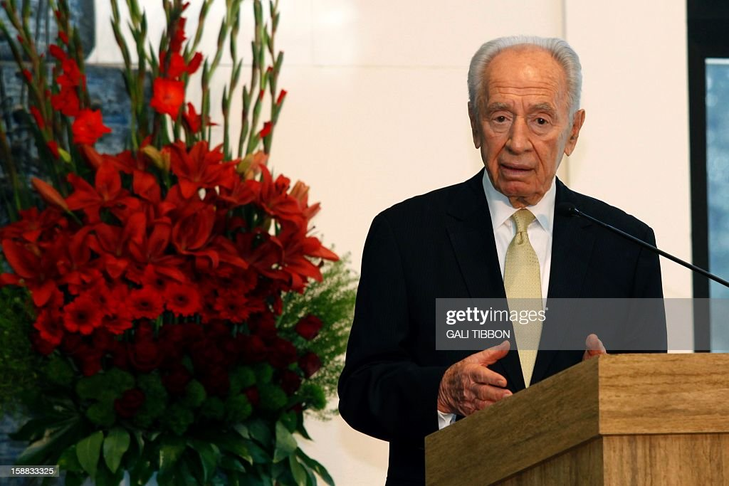 Israeli President Shimon Peres addresses the heads of the Christian denominations in the Holy Land during the traditional reception on New Year's Eve at the president's residency in Jerusalem on December 31, 2012.