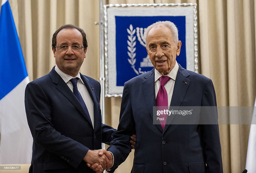 Israeli President <a gi-track='captionPersonalityLinkClicked' href=/galleries/search?phrase=Shimon+Peres&family=editorial&specificpeople=201775 ng-click='$event.stopPropagation()'>Shimon Peres</a> (R) and French President Francois Hollande shake hands during a meeting at the Israeli president's residence on November 17, 2013 in Tel Aviv, Israel. Hollande landed at Israel's Ben Gurion airport for a three-day visit in Israel and the West Bank.