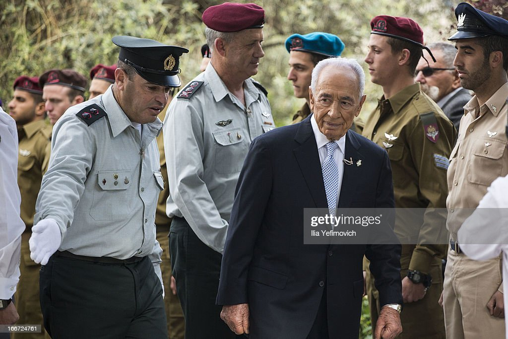 Israeli President <a gi-track='captionPersonalityLinkClicked' href=/galleries/search?phrase=Shimon+Peres&family=editorial&specificpeople=201775 ng-click='$event.stopPropagation()'>Shimon Peres</a> and IDF chief of staff Benny Gantz greet outstanding soldiers during a 'Singing Independence' ceremony in honour of outstanding soldiers, as part of Israel's 65th Independence Day celebrations, at the President's Residence on April 16, 2013 in Jerusalem, Israel. 120 outstanding soldiers and officers were honoured during the event.