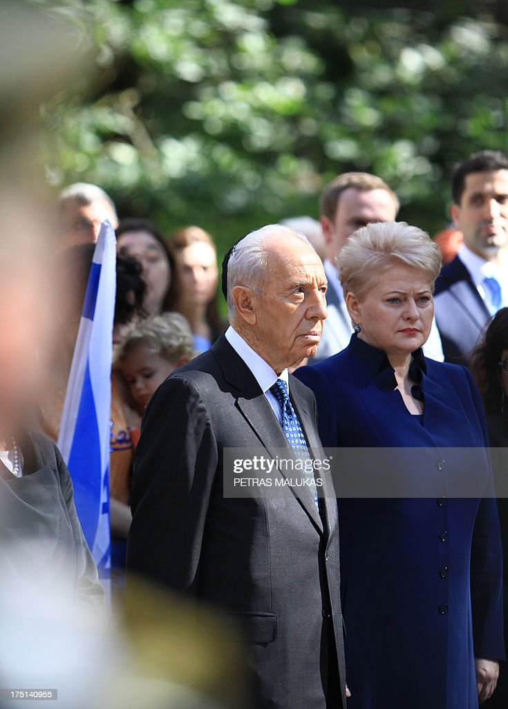 Israeli President Shimon Peres, (C) and Lithuania's counterpart Dalia Grybauskaite (R) are pictured during the ceremony, marking the Holocaust Remembrance day at the Paneriai memorial in Vilnius on August 1, 2013.
