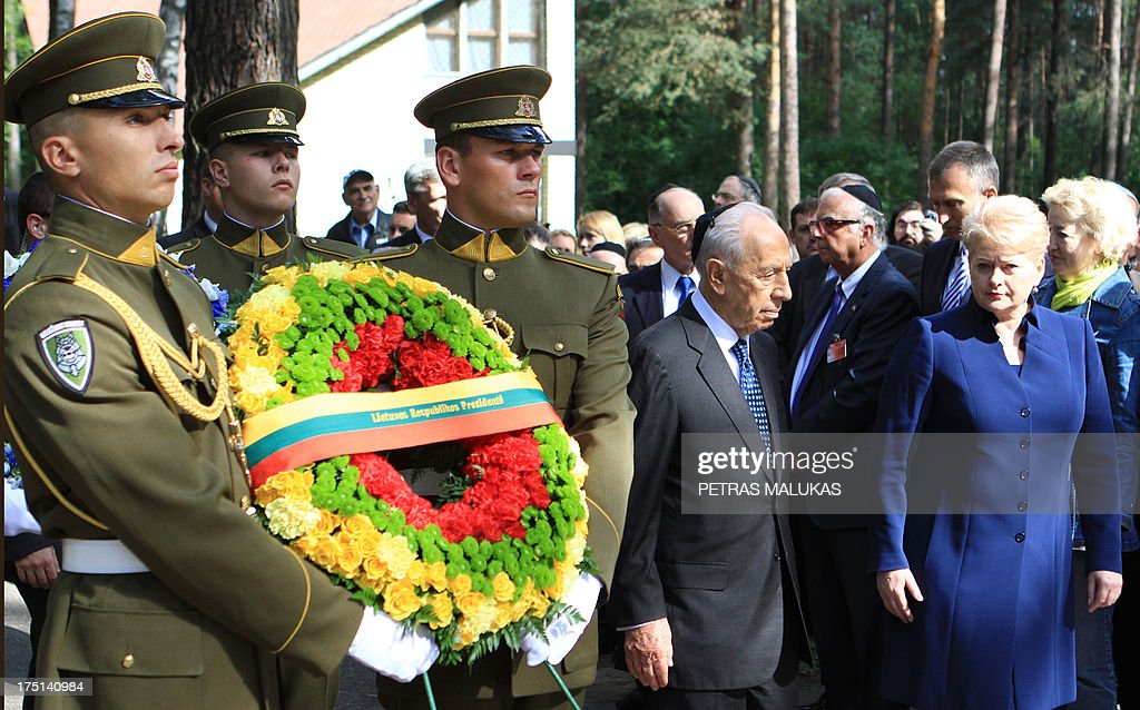 Israeli President Shimon Peres (4th L) and Lithuania's counterpart Dalia Grybauskaite (R) are pictured during the annual ceremony, marking the Holocaust Remembrance day, at the Paneriai memorial in Vilnius on August 1, 2013.