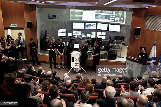 Israeli President Shimon Peres and Space IL engineers introduce the new prototype nano spaceship during a press conference on December 8 2011 in Ehud...