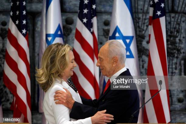 Israeli President Shimon Peres and US Secretary of State Hillary Clinton speak after a joint press conference on July 16 2012 in Jerusalem Israel...