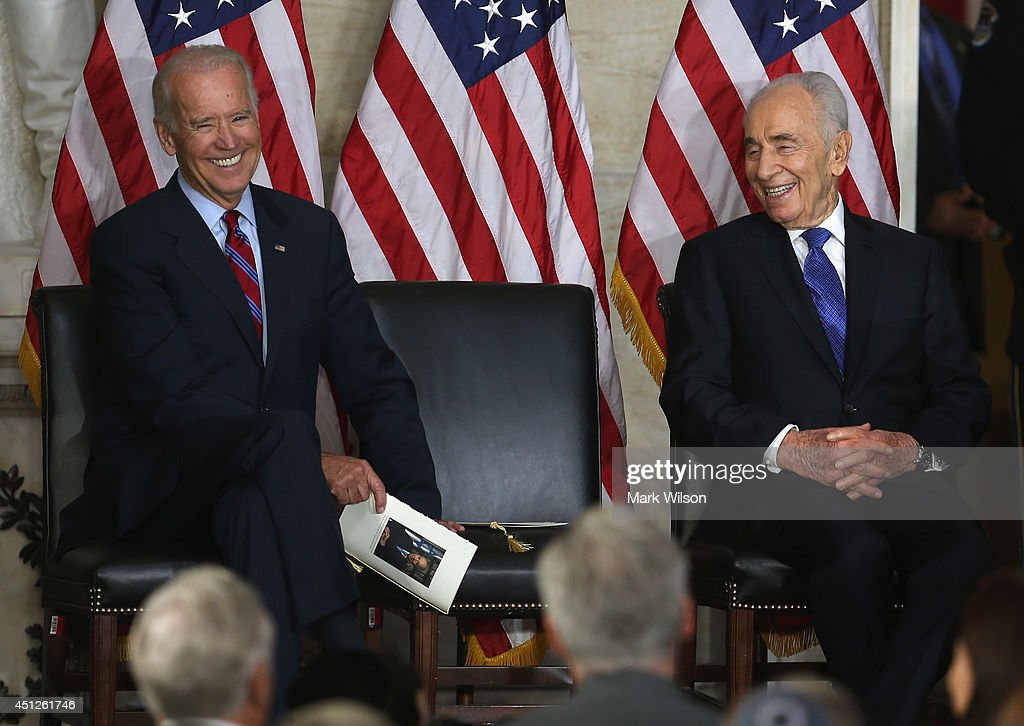 Israeli President <a gi-track='captionPersonalityLinkClicked' href=/galleries/search?phrase=Shimon+Peres&family=editorial&specificpeople=201775 ng-click='$event.stopPropagation()'>Shimon Peres</a> (R) and U.S. Vice President <a gi-track='captionPersonalityLinkClicked' href=/galleries/search?phrase=Joseph+Biden&family=editorial&specificpeople=206897 ng-click='$event.stopPropagation()'>Joseph Biden</a> share a laugh during a Congressional Gold Medal during a ceremony at the U.S. Capitol, June 26, 2014 in Washington, DC. President Peres was presented with the Congressional Gold Medal that recognizes those who have performed an achievement that has an impact on American history and culture. Photo by Mark Wilson/Getty Images)