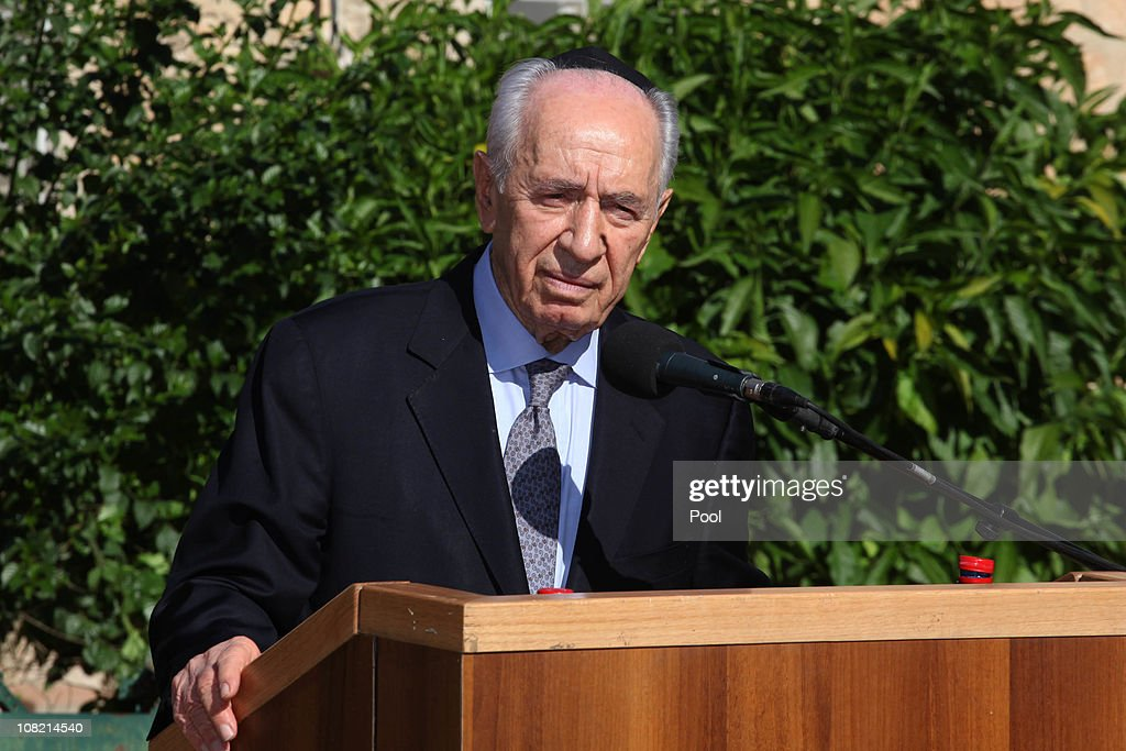 Israeli President Shimon Peres eulogizes his wife Sonia, during her funeral ceremony on January 21, 2011 in Ben Shemen, Israel. Thousands of people including state dignitaries and friends, attended the funeral of the Israeli Priesident's wife, Sonia, who died in her sleep on 20 January 2011 aged 87. The couple were married for 67 years.