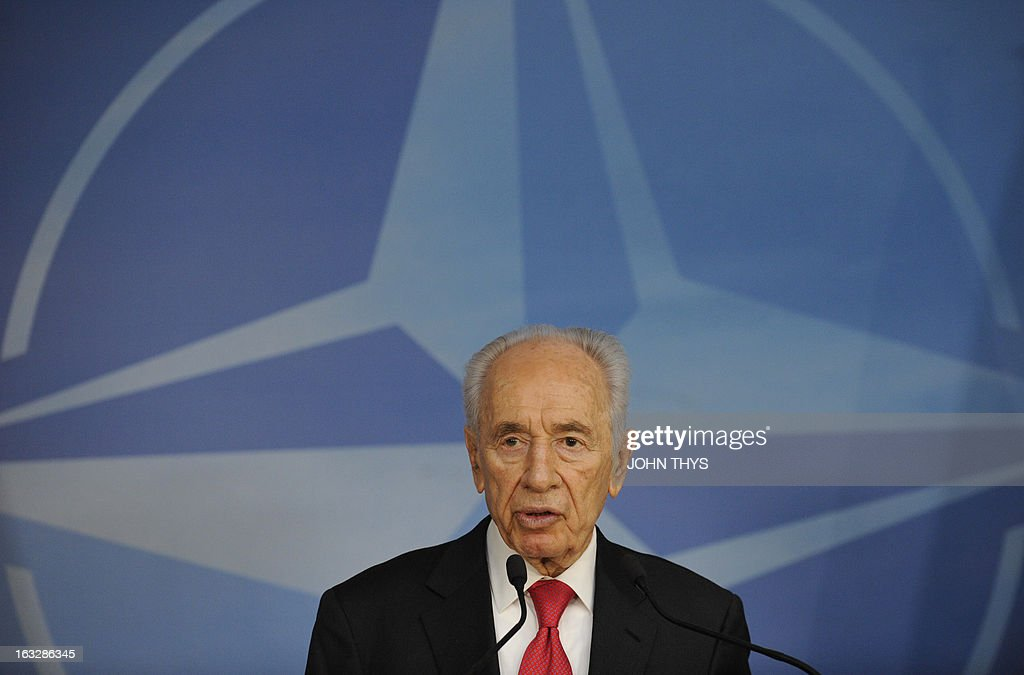 Israeli President Shimon Peres gives a press conference on March 7, 2013 after a bilateral meeting with the North Atlantic Treaty Organization (NATO) secretary-general at organization headquarters in Brussels. THYS