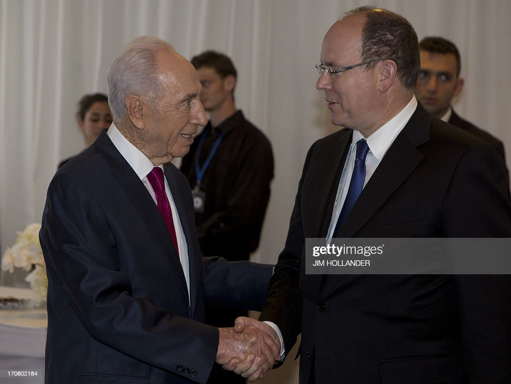 Israeli President Shimon Peres (L) greets Prince Albert II of Monaco at a convention centre in Jerusalem on June 18, 2013, a few hours before the gala celebrating the Israeli leader's 90th birthday. A slew of stars, politicians and public figures were flocking to Jerusalem to take part in Peres's birthday celebrations.