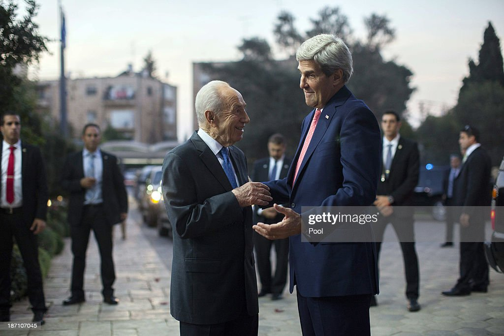 Israeli President Shimon Peres (L) greets U.S. Secretary of State John Kerry as the U.S. diplomat arrives at the Peres' residence November 6, 2013 in Jerusalem, Israel. Kerry also met yesterday with Israeli Prime Minister Benjamin Netanyahu and Palestinian President Mahmoud Abbas in an effort to boost Israeli-Palestinian peace talks.