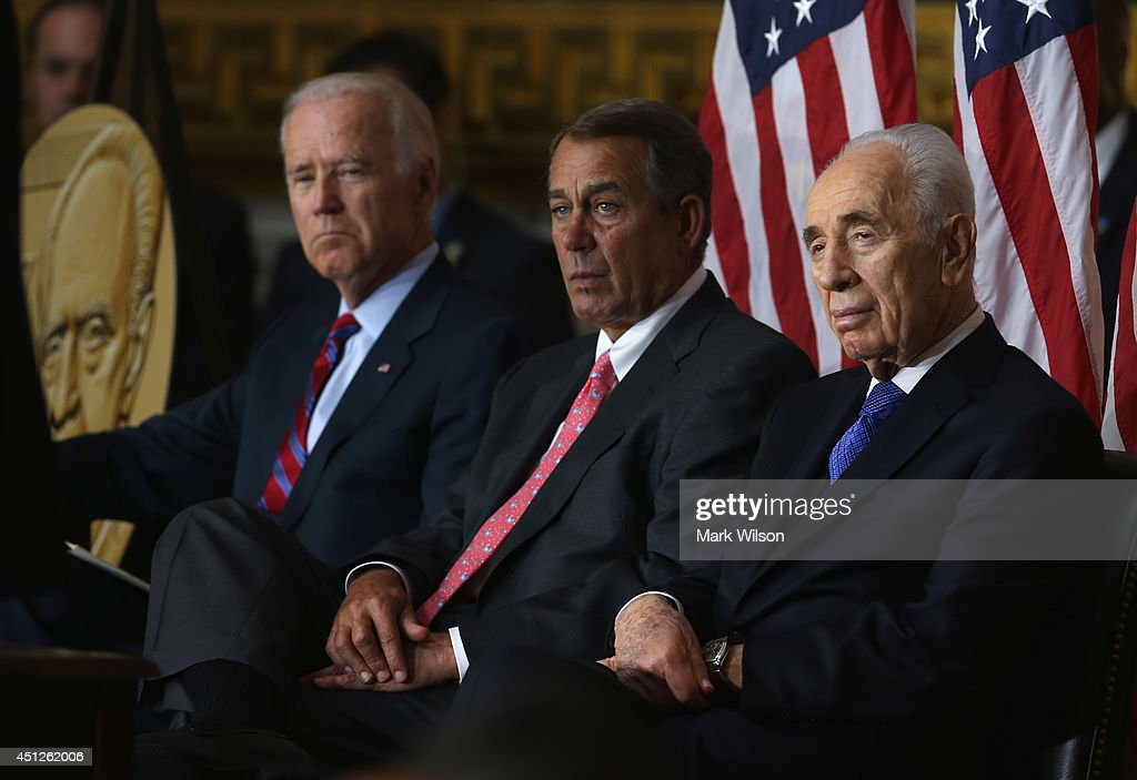 Israeli President <a gi-track='captionPersonalityLinkClicked' href=/galleries/search?phrase=Shimon+Peres&family=editorial&specificpeople=201775 ng-click='$event.stopPropagation()'>Shimon Peres</a> (R), House Speaker <a gi-track='captionPersonalityLinkClicked' href=/galleries/search?phrase=John+Boehner&family=editorial&specificpeople=274752 ng-click='$event.stopPropagation()'>John Boehner</a> (R-OH) (C), U.S. Vice President <a gi-track='captionPersonalityLinkClicked' href=/galleries/search?phrase=Joseph+Biden&family=editorial&specificpeople=206897 ng-click='$event.stopPropagation()'>Joseph Biden</a> (L) listen during a Congressional Gold Medal ceremony at the U.S. Capitol, June 26, 2014 in Washington, DC. President Peres was pressented with the Congressional Gold Medal which recognizes those who have performed an achievement that has an impact on American history and culture. Photo by Mark Wilson/Getty Images)