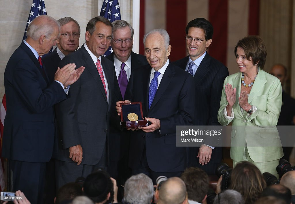 Israeli President Shimon Peres (C) is presented with the Congressional Gold Medal during a ceremony at the U.S. Capitol, June 26, 2014 in Washington, DC. Also pictures are (L-R) Vice President Joseph Biden, Senate Majority Leader Harry Reid (D-NV), House Speaker John Boehner (R-OH), Senate Minority Leader Mitch McConnell (R-KY), President Shimon Peres, outgoing House Majority Leader Eric Cantor (R-VA), House Minority Leader Nancy Pelosi