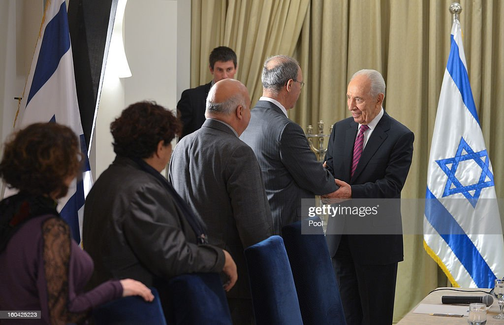 Israeli President <a gi-track='captionPersonalityLinkClicked' href=/galleries/search?phrase=Shimon+Peres&family=editorial&specificpeople=201775 ng-click='$event.stopPropagation()'>Shimon Peres</a> Israeli President <a gi-track='captionPersonalityLinkClicked' href=/galleries/search?phrase=Shimon+Peres&family=editorial&specificpeople=201775 ng-click='$event.stopPropagation()'>Shimon Peres</a> (R) meets with representatives of Hadash (Democatic Front for Peace and Equality) to discuss forming a new Israeli government on January 31, 2013 in Jerusalem, Israel. Israel has begun its post-election process of forming a new government with President <a gi-track='captionPersonalityLinkClicked' href=/galleries/search?phrase=Shimon+Peres&family=editorial&specificpeople=201775 ng-click='$event.stopPropagation()'>Shimon Peres</a> hosting the heads of the major political parties for consultations before deciding on whom to choose as prime minister-designate to form a new coalition.
