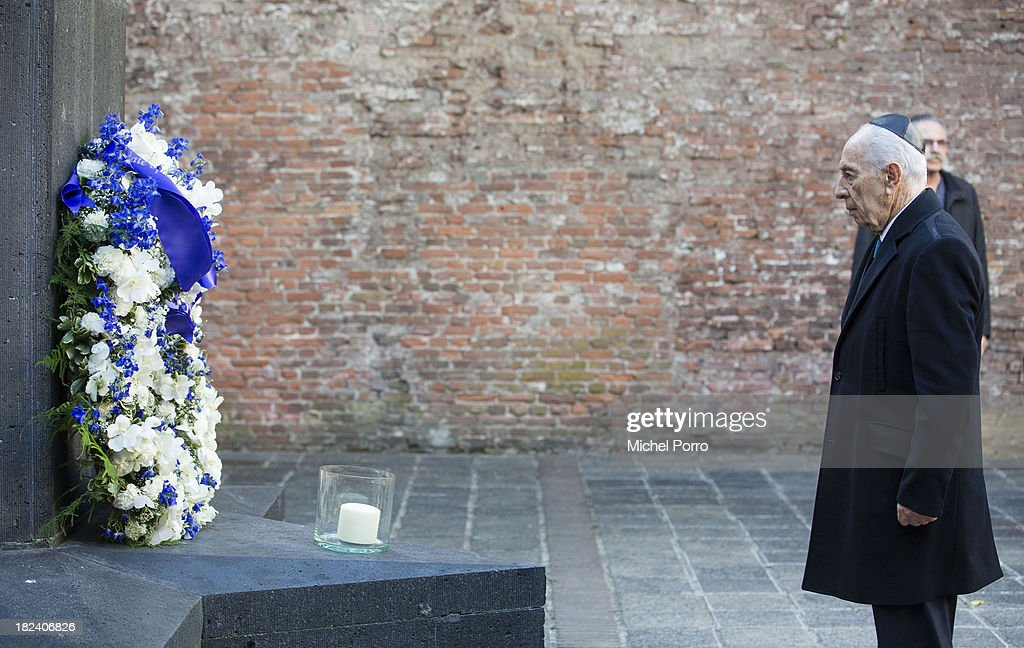 Israeli President <a gi-track='captionPersonalityLinkClicked' href=/galleries/search?phrase=Shimon+Peres&family=editorial&specificpeople=201775 ng-click='$event.stopPropagation()'>Shimon Peres</a> lays a wreath during his visit to the Dutch Theatre (Hollandsche Schouwburg) on September 29, 2013 in Amsterdam, Netherlands. The theatre was used as a location to deport Jews in the second World War and is now a monument. Peres is on an official four day visit to the Netherlands.