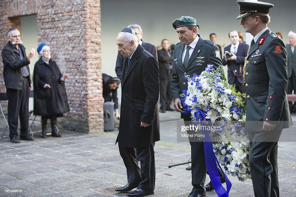 Israeli President <a gi-track='captionPersonalityLinkClicked' href=/galleries/search?phrase=Shimon+Peres&family=editorial&specificpeople=201775 ng-click='$event.stopPropagation()'>Shimon Peres</a> lays a wreath during his visit to the Dutch Theatre on September 29, 2013 in Amsterdam, Netherlands. The theatre was used as a location to deport Jews in the second World War and is now a monument. Peres is on an official four day visit to the Netherlands.