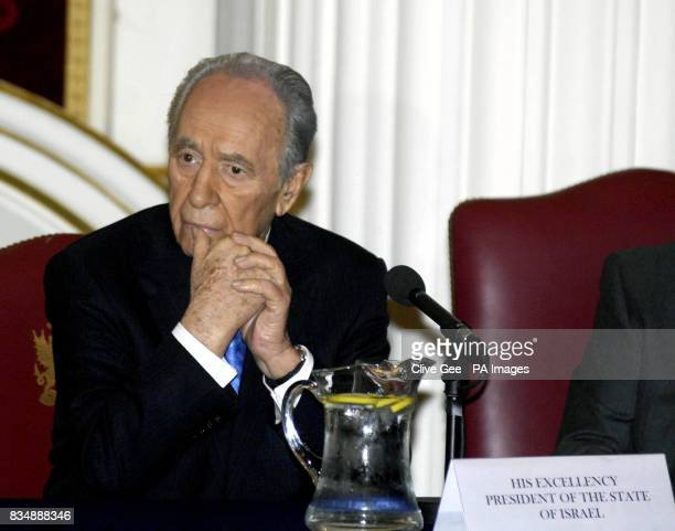 Israeli President Shimon Peres listens as he is introduced by the Lord Mayor of London Alderman Ian Luder at Mansion House in London after he...