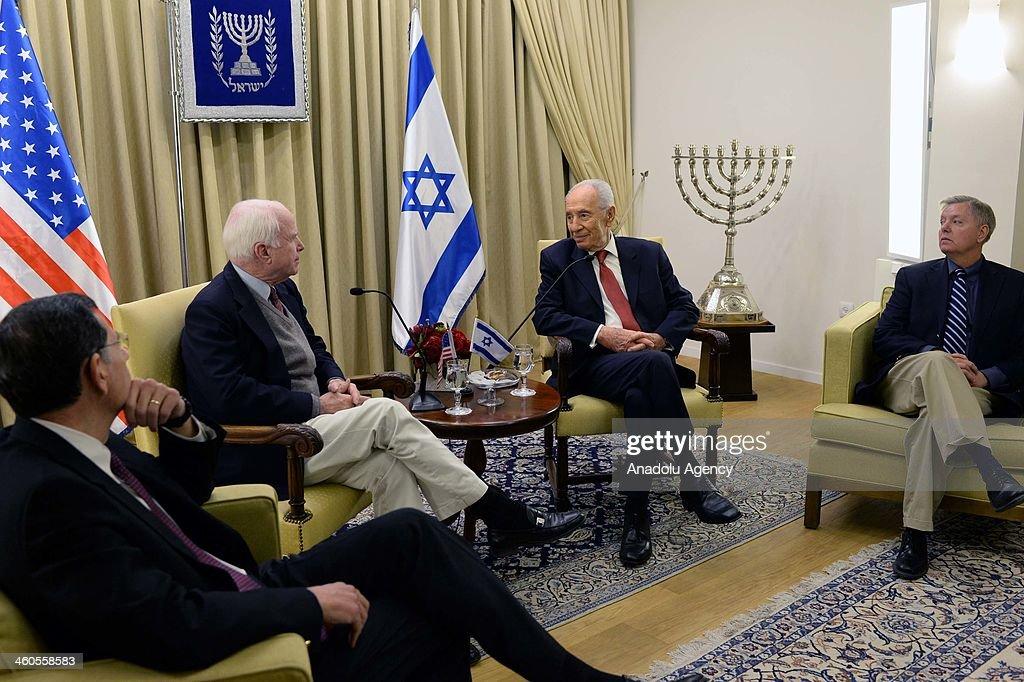 Israeli President Shimon Peres meets United States Senator John McCain at the President's residence in Jerusalem Israel on January 4 2014