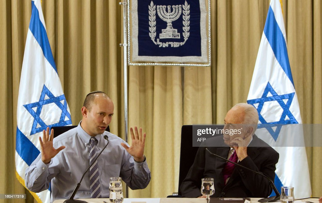 Israeli President Shimon Peres (R) meets with Naftali Bennett, head of hardline national-religious Jewish Home party, at the president's residence in Jerusalem on January 31, 2013. Peres has begun meeting party representatives as part of a formal post-election process that should see Prime Minister Benjamin Netanyahu asked to form a new government coalition.