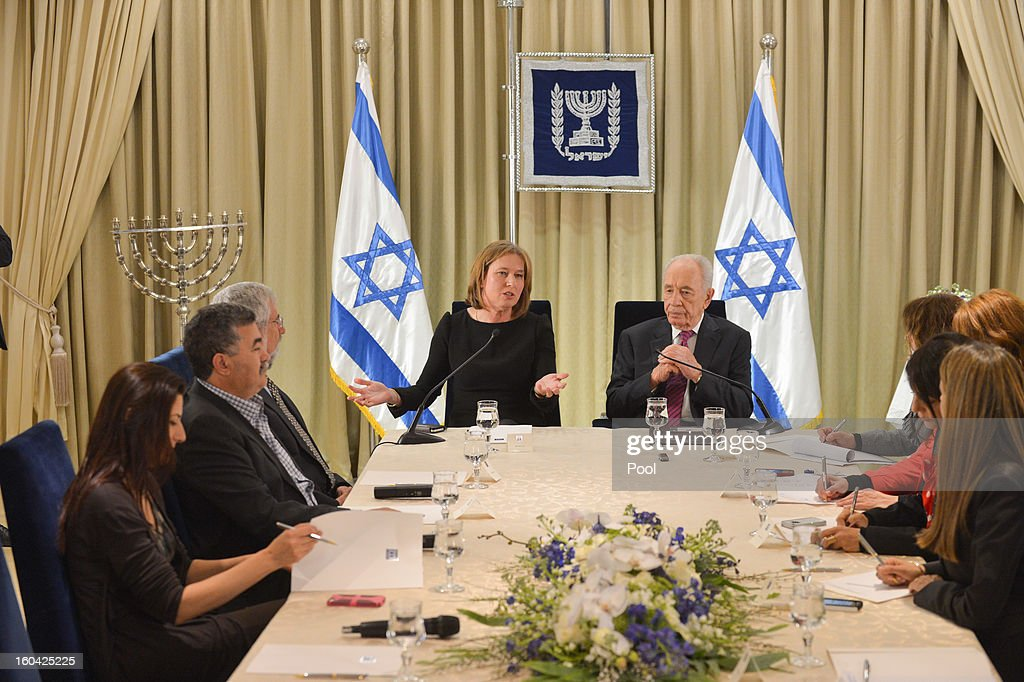 Israeli President <a gi-track='captionPersonalityLinkClicked' href=/galleries/search?phrase=Shimon+Peres&family=editorial&specificpeople=201775 ng-click='$event.stopPropagation()'>Shimon Peres</a> (R) meets with representatives of Hatenua (the Movement Party) chaired by <a gi-track='captionPersonalityLinkClicked' href=/galleries/search?phrase=Tzipi+Livni&family=editorial&specificpeople=537394 ng-click='$event.stopPropagation()'>Tzipi Livni</a> (L) to discuss forming a new Israeli government on January 31, 2013 in Jerusalem, Israel. Israel has begun its post-election process of forming a new government with President <a gi-track='captionPersonalityLinkClicked' href=/galleries/search?phrase=Shimon+Peres&family=editorial&specificpeople=201775 ng-click='$event.stopPropagation()'>Shimon Peres</a> hosting the heads of the major political parties for consultations before deciding on whom to choose as prime minister-designate to form a new coalition.