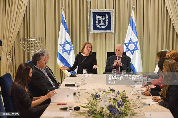 Israeli President Shimon Peres meets with representatives of Hatenua chaired by Tzipi Livni to discuss forming a new Israeli government on January 31...