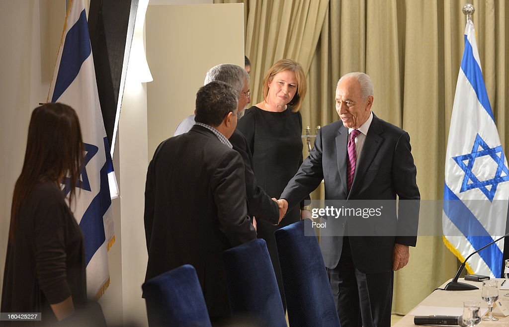Israeli President <a gi-track='captionPersonalityLinkClicked' href=/galleries/search?phrase=Shimon+Peres&family=editorial&specificpeople=201775 ng-click='$event.stopPropagation()'>Shimon Peres</a> (R) meets with representatives of Hatenua (the Movement Party) chaired by <a gi-track='captionPersonalityLinkClicked' href=/galleries/search?phrase=Tzipi+Livni&family=editorial&specificpeople=537394 ng-click='$event.stopPropagation()'>Tzipi Livni</a> (2nd-R) to discuss forming a new Israeli government on January 31, 2013 in Jerusalem, Israel. Israel has begun its post-election process of forming a new government with President <a gi-track='captionPersonalityLinkClicked' href=/galleries/search?phrase=Shimon+Peres&family=editorial&specificpeople=201775 ng-click='$event.stopPropagation()'>Shimon Peres</a> hosting the heads of the major political parties for consultations before deciding on whom to choose as prime minister-designate to form a new coalition.