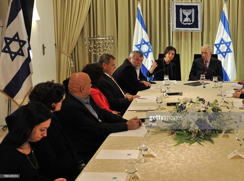 Israeli President Shimon Peres (R) meets with representatives of Meretz headed by Zahava Gal-On (2nd-R) to discuss forming a new Israeli government on January 31, 2013 in Jerusalem, Israel. Israel has begun its post-election process of forming a new government with President Shimon Peres hosting the heads of the major political parties for consultations before deciding on whom to choose as prime minister-designate to form a new coalition.