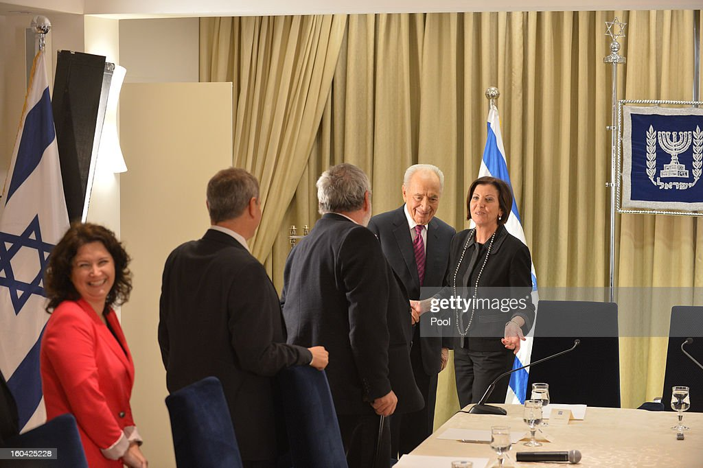 Israeli President Shimon Peres (2nd-R) meets with representatives of Meretz headed by Zahava Gal-On (R) to discuss forming a new Israeli government on January 31, 2013 in Jerusalem, Israel. Israel has begun its post-election process of forming a new government with President Shimon Peres hosting the heads of the major political parties for consultations before deciding on whom to choose as prime minister-designate to form a new coalition.