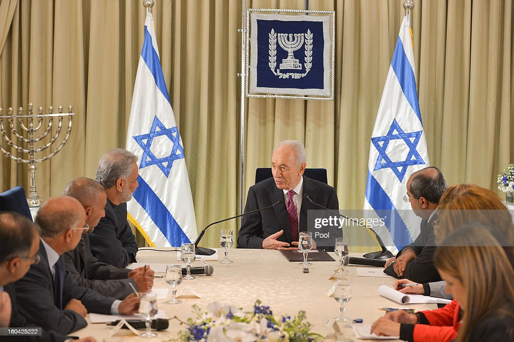 Israeli President <a gi-track='captionPersonalityLinkClicked' href=/galleries/search?phrase=Shimon+Peres&family=editorial&specificpeople=201775 ng-click='$event.stopPropagation()'>Shimon Peres</a> (C) meets with representatives of Ra'am Ta'al (United Arab movement) headed by Ibrahim Sarsour to discuss forming a new Israeli government on January 31, 2013 in Jerusalem, Israel. Israel has begun its post-election process of forming a new government with President <a gi-track='captionPersonalityLinkClicked' href=/galleries/search?phrase=Shimon+Peres&family=editorial&specificpeople=201775 ng-click='$event.stopPropagation()'>Shimon Peres</a> hosting the heads of the major political parties for consultations before deciding on whom to choose as prime minister-designate to form a new coalition.