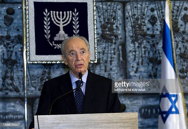 Israeli President Shimon Peres reads a statement just after Israeli Prime Minister Ehud Olmert submitted an official letter of resignation at the...