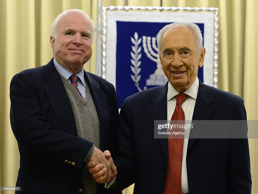 Israeli President Shimon Peres shakes hand with United States Senator John McCain at the President's residence in Jerusalem Israel on January 4 2014