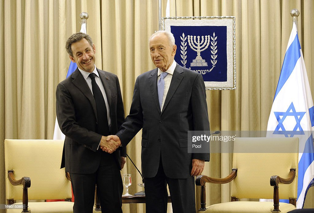 Israeli President <a gi-track='captionPersonalityLinkClicked' href=/galleries/search?phrase=Shimon+Peres&family=editorial&specificpeople=201775 ng-click='$event.stopPropagation()'>Shimon Peres</a> shakes hands with former French President <a gi-track='captionPersonalityLinkClicked' href=/galleries/search?phrase=Nicolas+Sarkozy&family=editorial&specificpeople=211375 ng-click='$event.stopPropagation()'>Nicolas Sarkozy</a> during his visit to Jerusalem on May 23, 2013 in Jerusalem, Israel. Sarkozy has been awarded an honorary degree by Netanya Academic College in recognition of his services to the Jewish people.