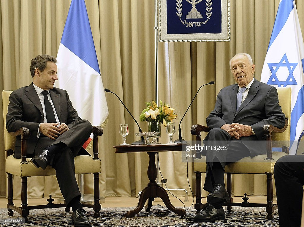 Israeli President Shimon Peres shakes hands with former French President Nicolas Sarkozy during his visit to Jerusalem on May 23, 2013 in Jerusalem, Israel. Sarkozy has been awarded an honorary degree by Netanya Academic College in recognition of his services to the Jewish people.
