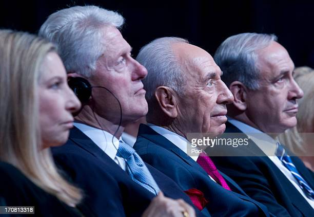 Israeli President Shimon Peres sits with former US President Bill Clinton during his 90th birthday gala June 18 2013 in Jerusalem Israel At left is...