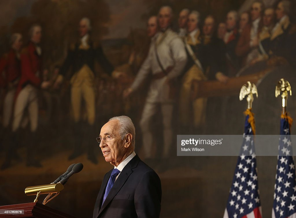 Israeli President <a gi-track='captionPersonalityLinkClicked' href=/galleries/search?phrase=Shimon+Peres&family=editorial&specificpeople=201775 ng-click='$event.stopPropagation()'>Shimon Peres</a> speaks after being presented with the Congressional Gold Medal during a ceremony at the U.S. Capitol, June 26, 2014 in Washington, DC. The Congressional Gold Medal recognizes those who have performed an achievement that has an impact on American history and culture.