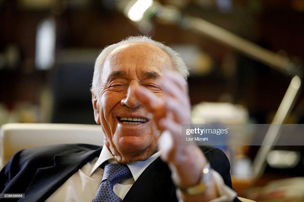 Israeli President Shimon Peres speaks smiles during an interview in the President house on April 10, 2013 in Jerusalem, Israel.