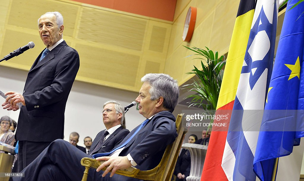 Israeli president Shimon Peres (L) talks as Crown Prince Philippe of Belgium (C) and Belgian Vice Prime Minister and Foreign Minister Didier Reynders (R) listen, on the first day Peres' visit to Belgium on March 5, 2013 at the Egmont Palace in Brussels. Belgium Out