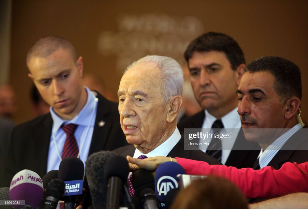 Israeli President <a gi-track='captionPersonalityLinkClicked' href=/galleries/search?phrase=Shimon+Peres&family=editorial&specificpeople=201775 ng-click='$event.stopPropagation()'>Shimon Peres</a> talks to journalists at the World Economic Forum on the Middle East and North Africa 2013 on May 26, 2013, in Dead Sea, Jordan. The forum runs May 24-26 and is being participated by 23 countries, under the theme of 'Advancing Conditions for Growth and Resilience.'