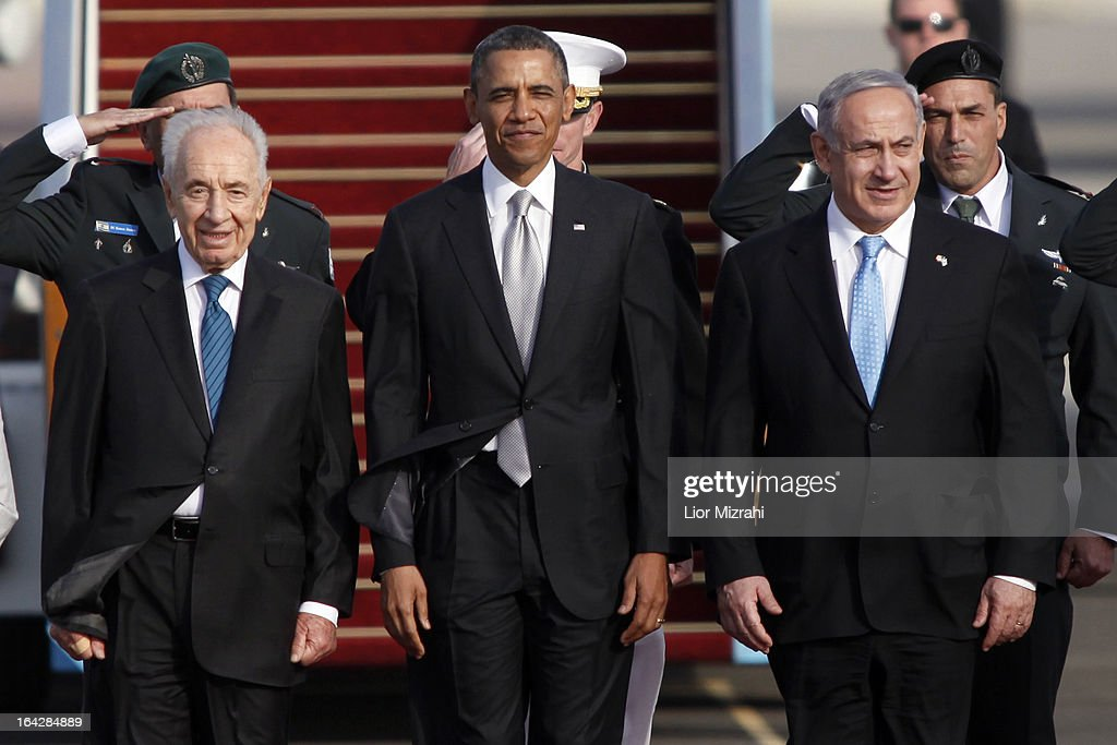 Israeli President Shimon Peres, U.S. President Barack Obama and Israeli Prime Minister Benjamin Netanyahu stand together prior to Obama departing from Ben Gurion International Airport on March 22, 2013 in Lod' Israel. Obama concluded his first visit to Israel and West Bank after three-days of meetings with Israeli and Palestinian leaders.