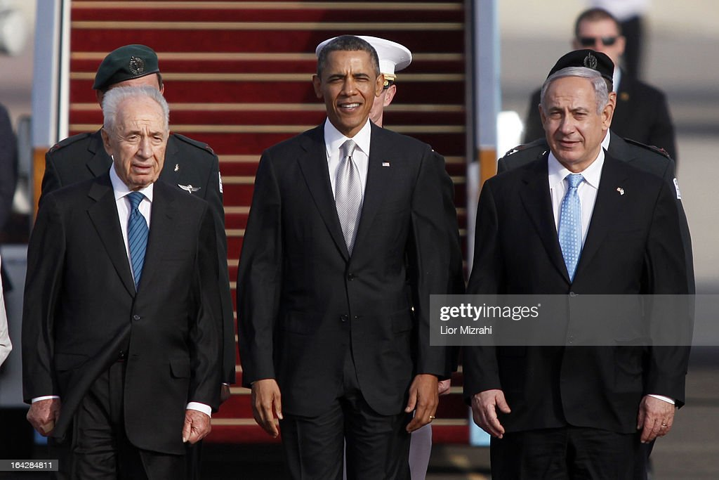 Israeli President Shimon Peres, U.S. President Barack Obama, Israeli Prime Minister Benjamin Netanyahu stand together prior to Obama departing from Ben Gurion International Airport on March 22, 2013 in Lod' Israel. Obama concluded his first visit to Israel and West Bank after three-days of meetings with Israeli and Palestinian leaders.