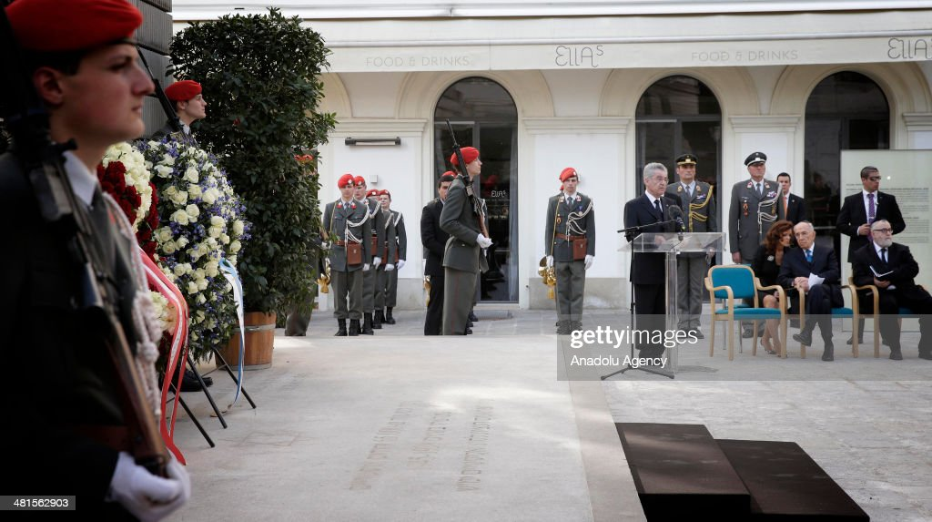 Israeli President Shimon Peres (2nd R) visits the memorial for Austrian victims of the Holocaust with President of Austria Heinz Fischer (3rd R) in Vienna, Austria, on March 30, 2014.